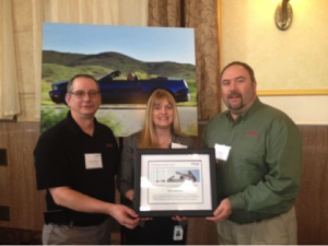 Doug Winfrey (left) and I (right) accept the Webasto 2014 Quality Excellence Award from Webasto Buyer Dawn Bostwick